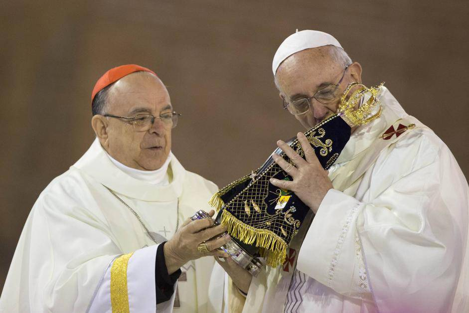 Pope Francis kisses the statue of the Virgin of Aparecida, Brazil's patron saint, during Mass in Aparecida Basilica, in Aparecida, Brazil, Wednesday, July 24, 2013. Reverence for the figure of the Virgin Mary runs particularly deep in Latin America. The Vatican says that Pope Francis personally insisted that a trip to the Aparecida Basilica be added to his Brazilian visit agenda. (AP Photo/Felipe Dana)