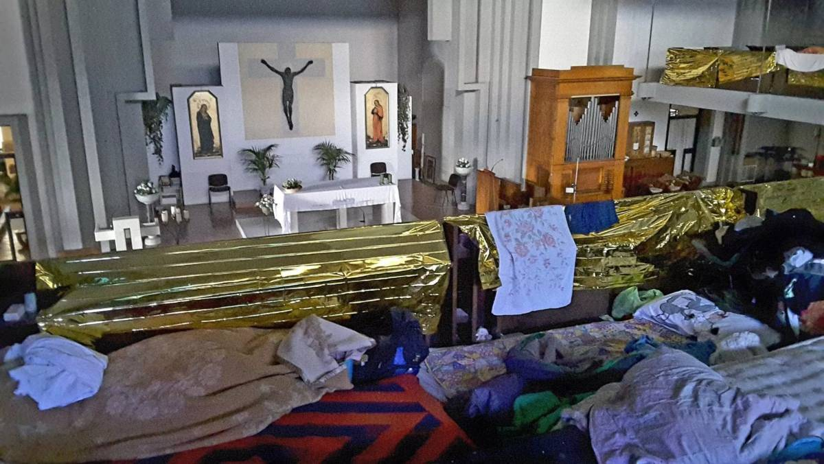 migranti chiesa