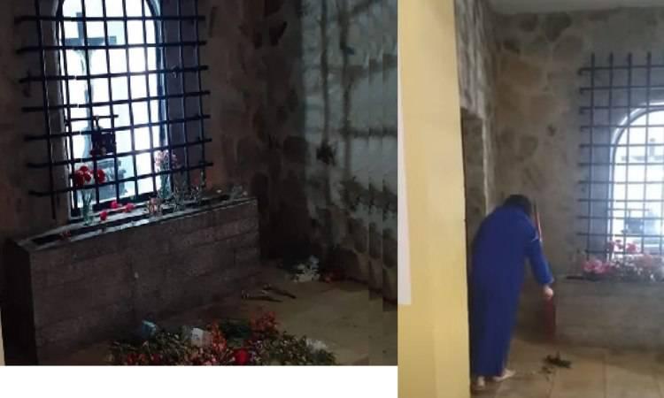donna musulmana che spazza davanti all'altare del Crocifisso
